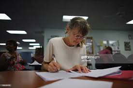 Gloria Richter fills out a job application for the bell ringing ...