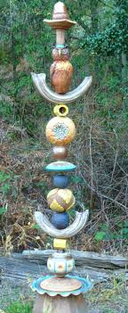 occidental pottery and wood garden totems older totem sold