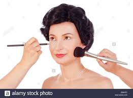 makeup artists preparing model for photo shoot isolated on white