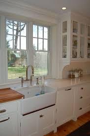 walnut trim under sink corbels under upper cabinets