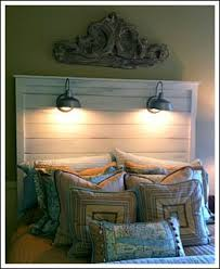 make your own lighting. make your own headboard attach wall lights to it instead of walls minimize lighting