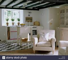 Cottage Kitchen Black White Tiled Floor In White Country Cottage Kitchen Open To A