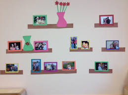 Just a great way to display children's family photos using construction  paper and some imagination.
