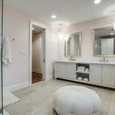 french country bathroom. soft pink walls, twin chandeliers create elegance in bathroom french country