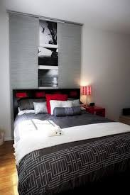 Awesome Color Blend In Modern Bedroom With Grey Cover And White Quilt Red  Pillow With Black Red Headboard Image