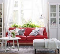 ikea a white living room with a red stocksund sofa liatorp cabinet and bookcase in white storage in calm white