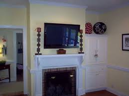 planning ideas mounting tv over fireplace smart for great fireplace mantels with tv above