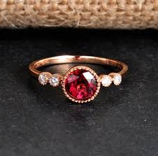 1 carat ruby and diamond antique enement ring in yellow gold
