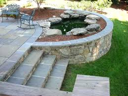 patio retaining wall ideas walls circular brick designs pictures building raised with against house kit p drainage how to build on slope seating semi circle
