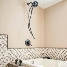 shower installed over jacuzzi bathtub