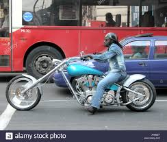 a biker on a modified chopper bike in london stock photo royalty