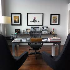This striking, contemporary home office space feels as luxurious as it is  functional. The