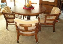 drexel heritage oak adjule height round dining game table and oak captain chairs on casters
