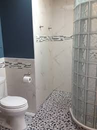bathroom remodel with curved barrier free glass block walk natural stone shower floor tile
