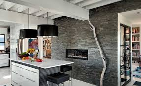 dimensional stacked stone fireplace with gas insert and feature wall in a kitchen in austin with