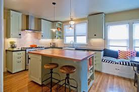 White Kitchen With Hardwood Floors Dark Brown Island With Open Shelves Hardwood Flooring White