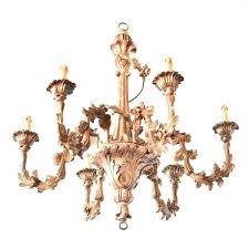 wood and iron chandelier carved the big from reclaimed