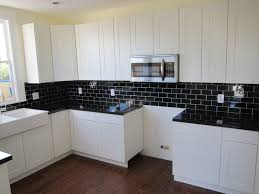 Granite Kitchen Tiles Black Granite With Black Subway Tile With Thick Grout Line In