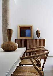 african furniture and decor. rattan dining chairs and an african vase for decor furniture l