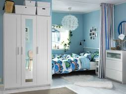 a light small bedroom furnished with a white metal bed for two combined with a bedside bedroom furniture at ikea