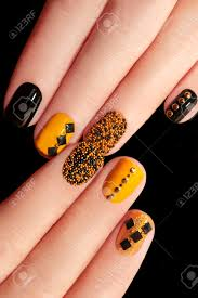 Caviar Manicure In Yellow Black Nails With Black And Gold ...