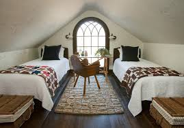 atlanta attic room with light wood bedroom and makeup vanities traditional quilted bedding star quilt