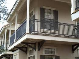 Simple Black Iron Balcony Railing Mixed With Large Glass Windows And White  Concrete Poles And House With Cream Walls