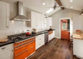 vintage details such as a split dutch door rustic floors a farmhouse sink and industrial elements all work well with the craftsman style
