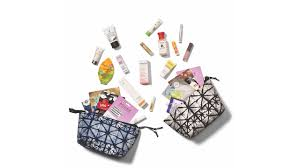 two whole foods beauty bags filled with miniaturesized beauty s spilling out of them on a