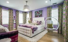 teens bedroom with purple walls carpet and see through swinging bubble chair with cushions