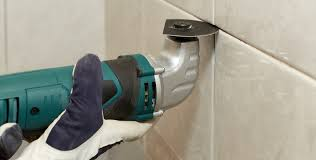 removing old grout with a tool