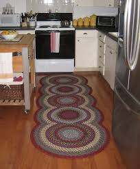 exclusive woven kitchen rugs in circular pattern using red and gray accent