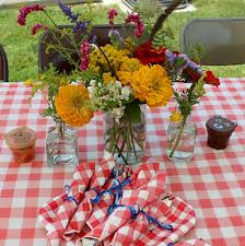 i made some arrangements for a friend s teddy picnic themed baby shower a few weeks ago the grandmother to be requested flowers with a meadow feel