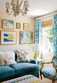 a colorful living room f schumacher zenyatta mondatta fabric in pea bench ottoman tan walls blue velvet sofa gold blue toile french chair green double