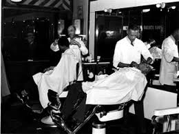 essay sharing my truth in a black barbershop two barbers trim the hair of their customers at the metropolitan barber shop late one evening 1940s photoquest getty images