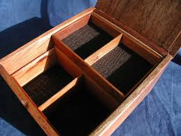 it says made in honduras and hecho a mano i added small wooden feet which helps the transformation from an ordinary cigar box to handsome valet box