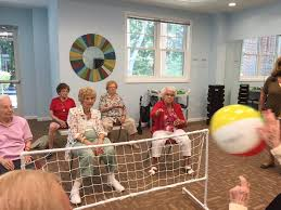 chair volleyball. played each other beachball volleyball. there were a lot of laughing going on. they built up hearty appetite for the ice cream social that followed. chair volleyball f