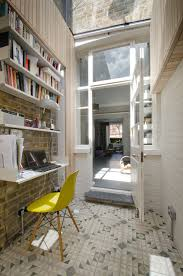 cool wall mounted bookshelves in home office contemporary with house extension design next to handicap accessible bathroom designs alongside floating desk bathroomcool home office desk