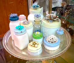 i was in a little antique looking in the glass cases and saw a lovely collection of small delicate white glass jars with embellished lids