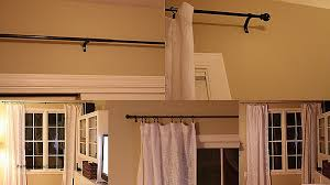 how to put curtains in a bay window beautiful how to put up net curtains a bay window soozone