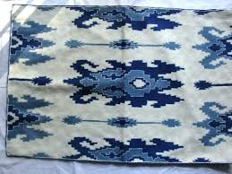 alluring blue rug on cream area reviews main ikat rugs ivory unique in the right blue ikat area rugs