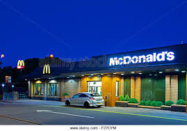restaurant uk car stock photos restaurant uk car stock images  car at mcdonald s drive in restaurant at night england uk stock image