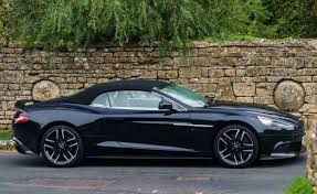aston martin 2018 black. if rain comes, the vanquish s volante\u0027s top raises at speeds up to 30 mph. after all, when you\u0027re dropping this kind of coin, you can\u0027t be expected come aston martin 2018 black