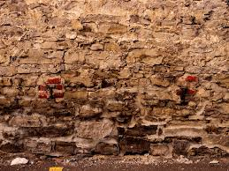 brick supports in old stone wall