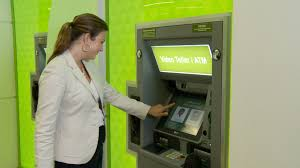 aba bank marketing a customer conducts a transaction on a video teller machine at regions bank s new concept branch