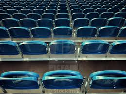 Tiered grandstand seating at an outdoor event horizontal format stock image our image licences