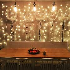 Draping And Fairy Lights For All Occasions White Feather Balloons And Sparkly Fairy Lights Make This A