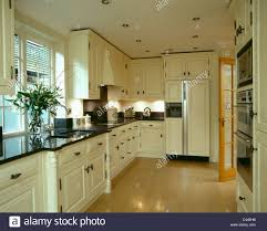 Kitchen Granite Worktop Cream Units With Black Granite Worktops In Kitchen With Laminated