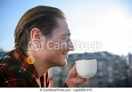 Standing man drinking coffee photos and images. Peaceful Guy Enjoying His Drink Outside On The Balcony Cheerful Adult Man Drinking Coffee On Terrace In The Morning He Is Canstock