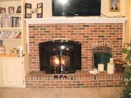 mps started with a wood burning zero clearance fireplace after demo we intalled an enviro m55 fpi with a painted finish against a slate back